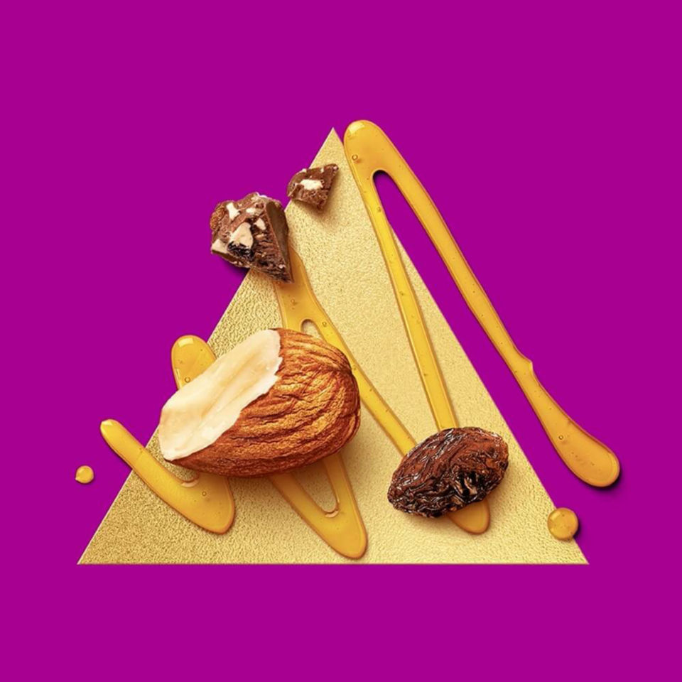nuts and chocolate on a golden triangle with purple background
